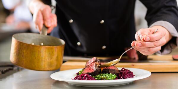 Chef Preparing a Meal (Photo: Kzenon/Shutterstock)