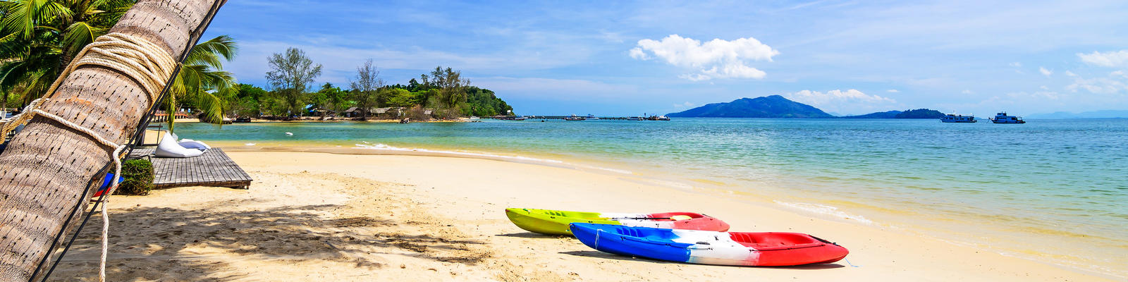 Kayaks on the Tropical Beach, Payam Island, Ranong, Thailand (Photo: Take Photo/Shutterstock)