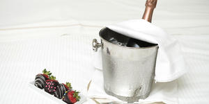 Champagne in Bucket Surrounded by Chocolate Covered Strawberries (Photo: RonTech3000/Shutterstock)