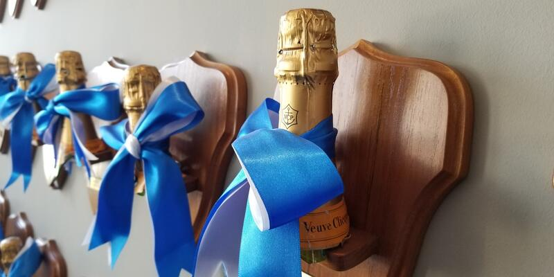 Before Viking started christening its ships with aquavit, it used the traditional Champagne. The bottles are mounted on plaques and hang in the company's corporate headquarters in Basel (Photo: Colleen McDaniel/Cruise Critic)