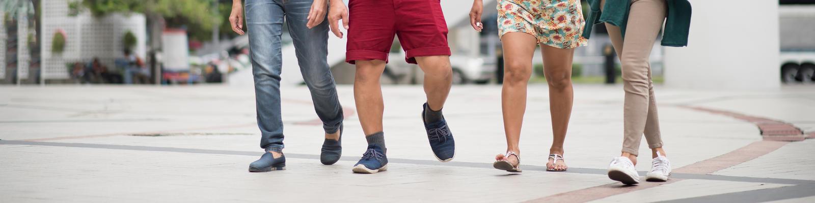 Group of friends walking on the street (Photo: crazystocker/Shutterstock)