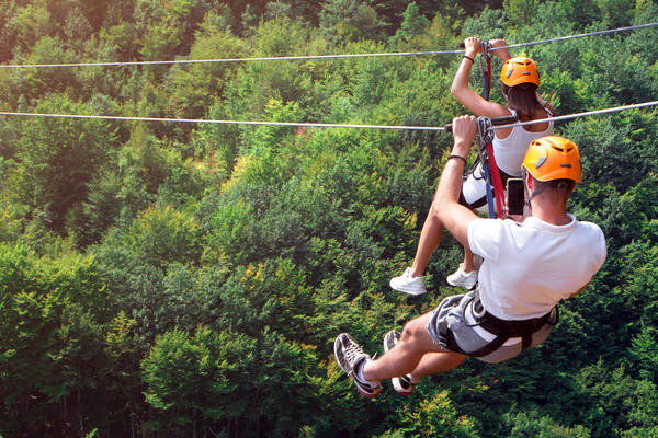 Couple Zip-lining in Exotic Destination (Photo: Mike_O/Shutterstock)