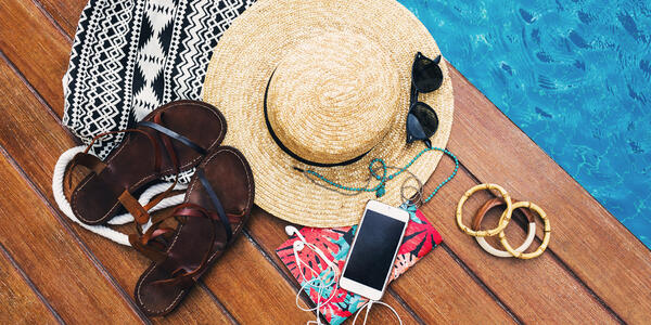 Personal Belongings Near Pool (Photo: Svitlana Sokolova/Shutterstock)