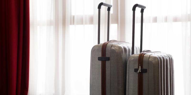Suitcases Near Window (Photo: FabrikaSimf/Shutterstock)