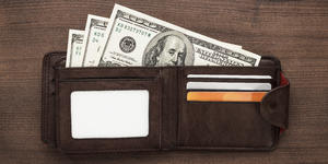 Wallet Stuffed With Hundreds (Photo: Ruslan Grumble/Shutterstock)