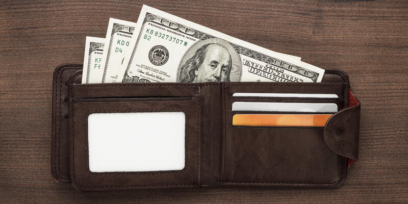 Wallet Stuffed With Hundreds (Photo: Ruslan Grumble/Shutterstock)