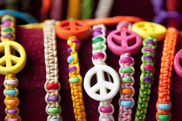 Brightly colored beaded bracelets with peace sign charms