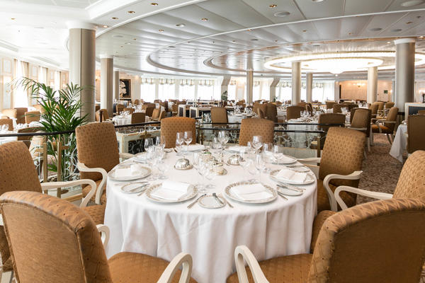 Round table with settings in Riviera's Grand Dining Room