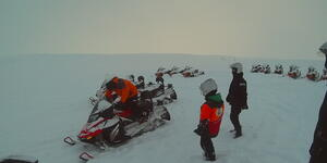 Snowmobiling on an Arctic shore excursion in Norway (Photo: Adam Coulter)