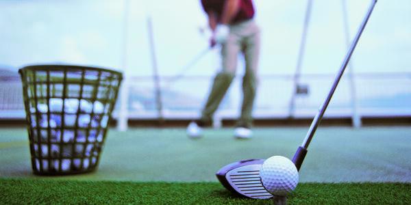 Man PLaying Golf on Norwegian Spirit (Photo: Norwegian Cruise Line)