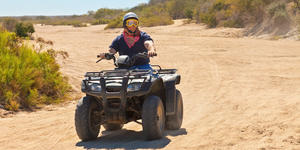 All Terrain Vehicle rider in Cabo San Lucas, Mexico (Photo: Ruth Peterkin/Shutterstock)