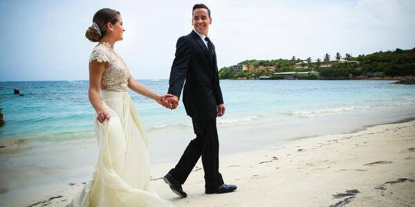 Married Couple Walking Along Shoreline (Photo: Royal Caribbean International)
