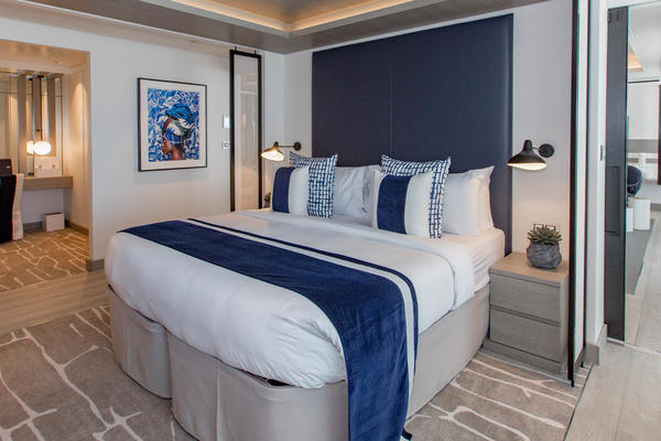 Photo of the blue and white bedroom area in Celebrity Edge's Penthouse Suite