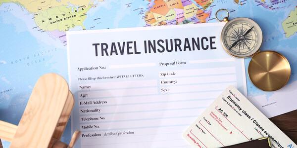 Travel Insurance Document (Photo: Africa Studio/Shutterstock)