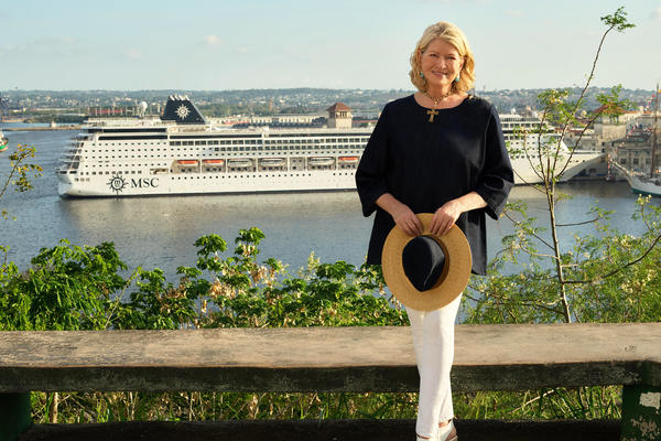 Photograph of Martha Stewart by the water with an MSC cruise ship docked in the background - photography by Douglas Friedman for MSC Cruises