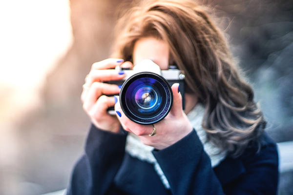Women Photographing Subject With Digital Camera (Photo: hispan/Shutterstock)