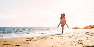 Mother Daughter Stroll on the Beach (Photo: AlessandroBiascioli/Shutterstock)