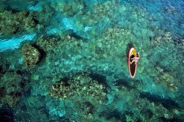 Paddle-Boarding in the Bahamas (Photo: Joe West/Shutterstock)