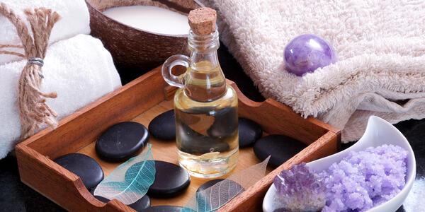 Aromatic Oil With Hot Stones for Massage (Photo: Mordasova Elena/Shutterstock)