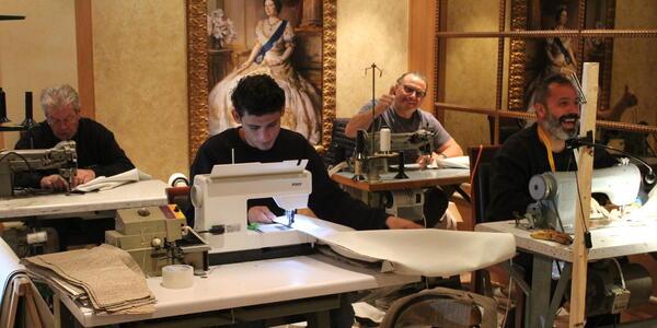 Craftsmen sewing in the Queens Room ballroom on Queen Elizabeth (Photo: Sarah Holt)
