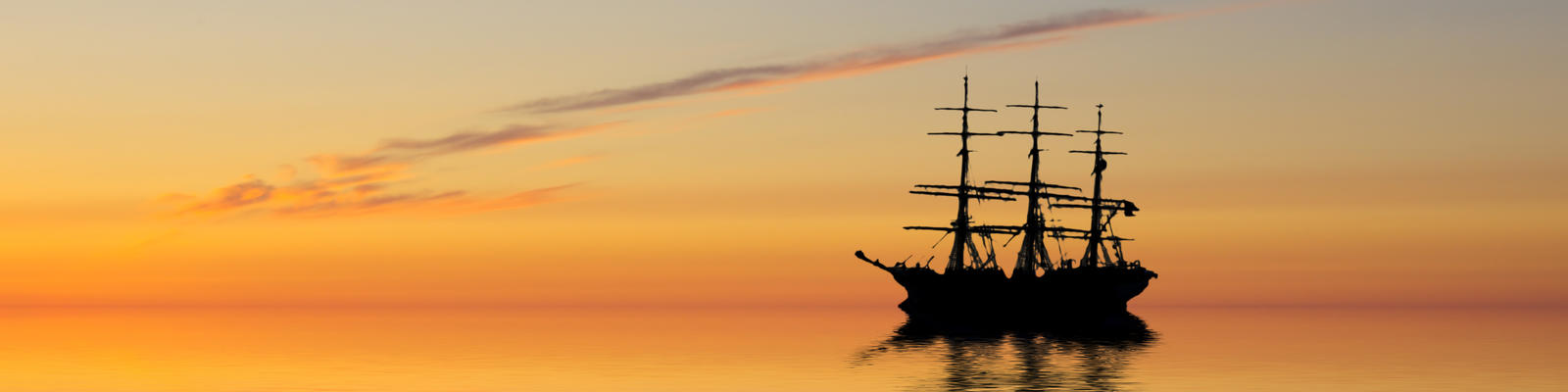 An abandoned ghost ship at sea (Photo: 23d/Shutterstock)