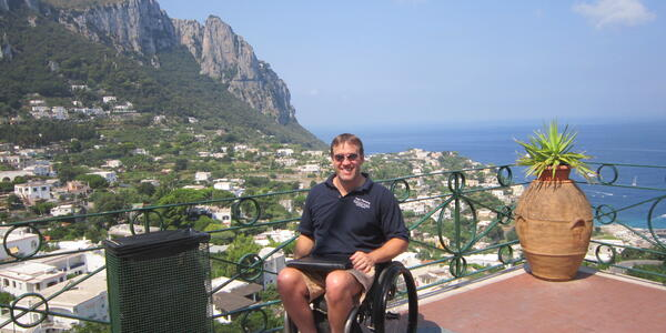 John Sage, owner and founder of Accessible Travel Solutions on a shore excursion in Capri, Italy (Photo: Silversea Cruises)
