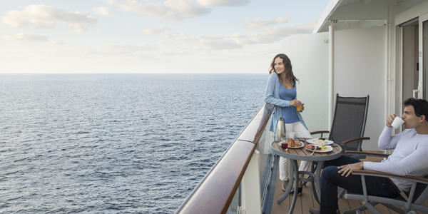 Couple enjoying a meal in their stateroom balcony (Photo: Celebrity Cruises)