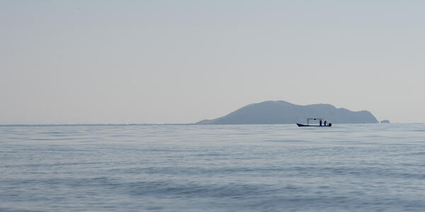 View of fishing boat at sea, Zihuatanejo, Guerrero, Mexico - Photograph by Keith Levit via Shutterstock