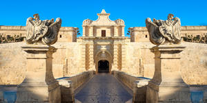 Photograch of the city gates of the old fortress city of Mdina in Valletta, Malta - Photography by Calin Stan via Shutterstock
