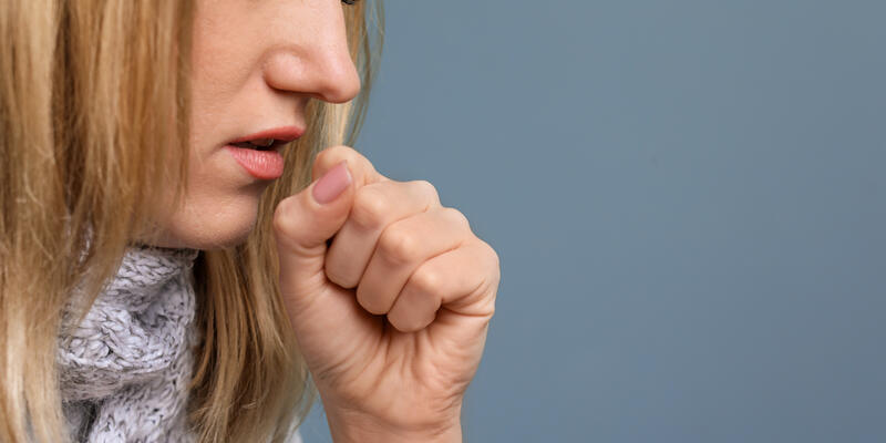 Young Woman Coughing (Photo: New Africa/Shutterstock)