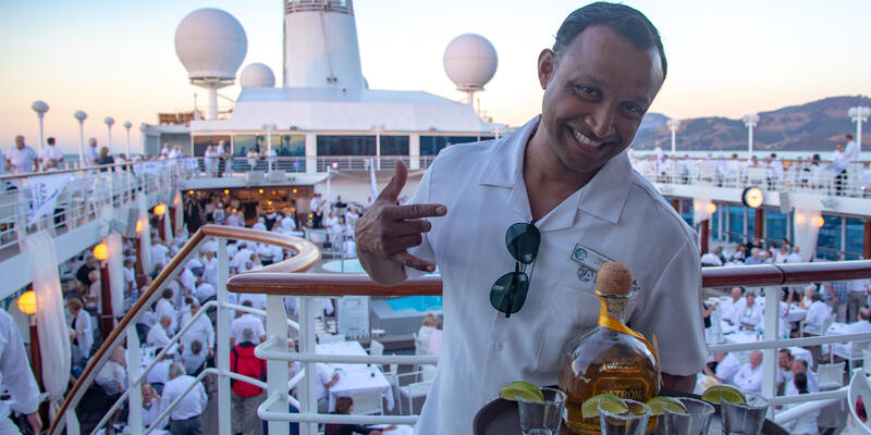 Waiter with tequila at White Party on Azamara (Photo: Tim Faircloth)