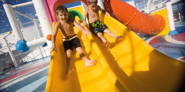 Children sliding on Carnival Splendor WaterWorks