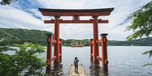 Traveler Photographing Lake Ashi, Japan (Photo: kitzcorner/Shutterstock)