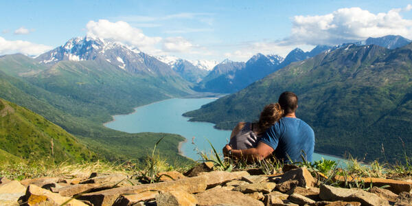 Couple Overlooking Eklutna Lake, Alaska (Photo: akingsley/Shutterstock)