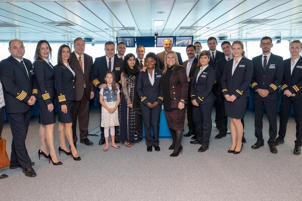 Image: Captain Kate, Lisa Lutoff-Perlo and godmother Malala Yousafzai alongside Celebrity Edge's Bridge team - Photo courtesy of Celebrity Cruises