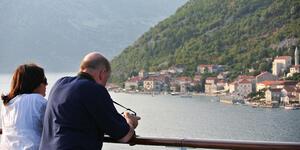Couple Enjoying the Mediterranean Views From Their Cabin (Photo: Regent Seven Seas)