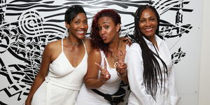 Image: Three ladies dressed in white for Festival at Sea's Annual White Night party - Photo courtesy of Festival at Sea via Blue World Travel Corp.