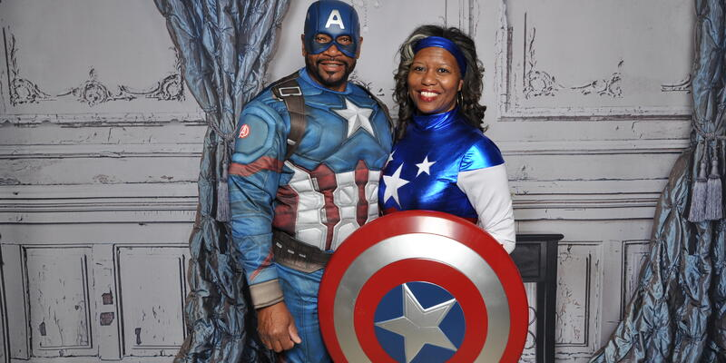 Image: African American couple dressed as super heroes Festival at Sea's costume party - Photo courtesy of Festival at Sea via Blue World Travel Corp.