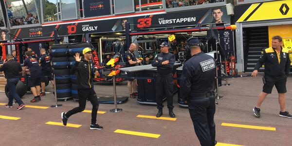 Formula 1 driver Daniel Ricciardo walking through the pits (in the yellow hat). Ricciardo won the Monaco Grand Prix in 2018. This is a real treat to see him. Photo by Liz Ciccone.