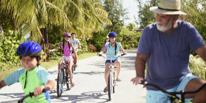 Family Biking on one of Castaway Cay's Bike Trails (Photo: Disney Cruise Line)