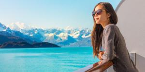 Woman Overlooking Alaska From Cabin (Photo: Maridav/Shutterstock)