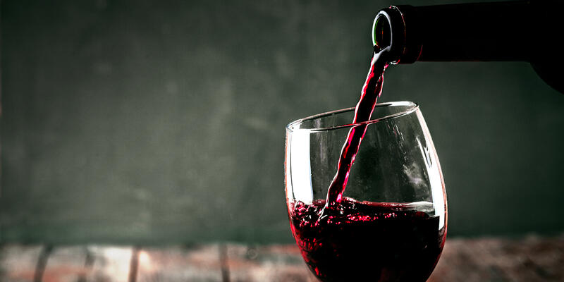 Wine Being Poured in Glass (Photo: mythja/Shutterstock)
