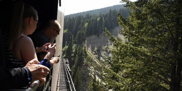 Passengers Photograph a Canyon During a Narrow Overpass on the Rocky Mountaineer Train (Photo: Christina Janansky/Cruise Critic)