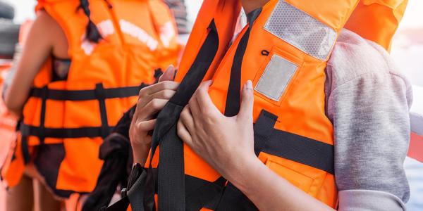 People Wearing Lifejackets (Photo: Chanintorn.v/Shutterstock)