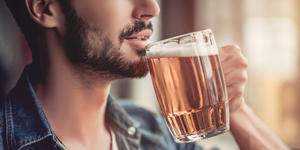 Man Drinking Beer (Photo: 4 PM production/Shutterstock)
