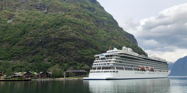 Exterior shot of Viking Jupiter docked in green and mountainous Flam, Norway