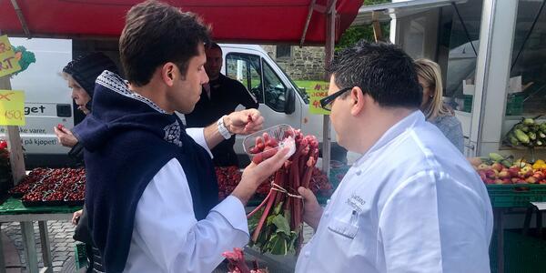 Two Viking Jupiter chefs tasting fresh produce in Norway