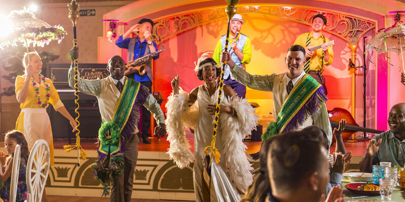 Costumed performers dancing at The New Orleans-inspired lounge on Disney Wonder