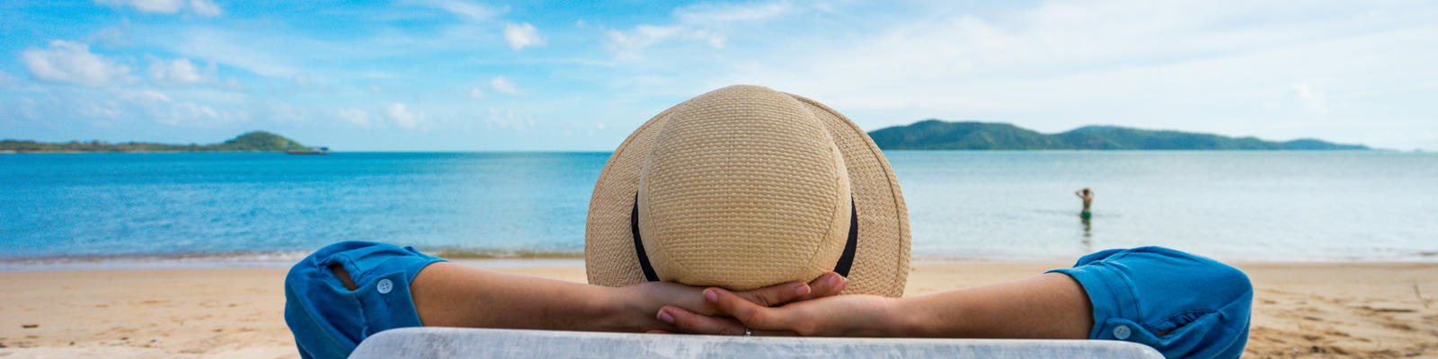 Woman Enjoying Vacation by Beach (Photo: PIXA/Shutterstock)