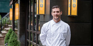 Portrait of Michelin-Starred chef Anthony Sasso in front of his on-land restaurant